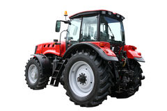 Red tractor. Separately on a white background Royalty Free Stock Image