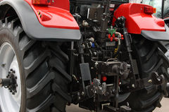 Red tractor. The rear view Royalty Free Stock Photo