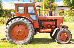 Red tractor closeup Royalty Free Stock Image