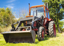 Red tractor closeup Royalty Free Stock Photo