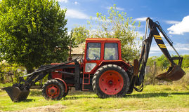 Red tractor closeup Royalty Free Stock Photography
