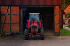 Red tractor on the farm Stock Image