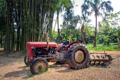 A Red Tractor in the farmland Royalty Free Stock Images