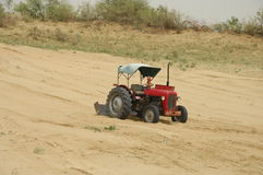Red tractor in field Royalty Free Stock Photos
