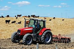 Tractor ploughing field, Andalusia, Spain. Royalty Free Stock Photo