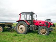 Red tractor in the field Royalty Free Stock Photography