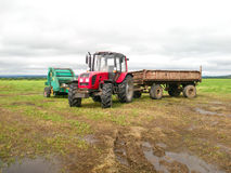 Red tractor in the field Stock Photography