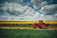 Red tractor in a field stock photography