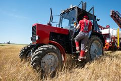 Red tractor in the field stock images