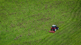 Red tractor on green field royalty free stock images