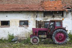 Red tractor. By the house royalty free stock images