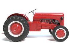 Red Tractor Isolated on white stock photos