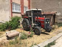 Red tractor parked Royalty Free Stock Photography