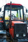 Red tractor. Royalty Free Stock Images
