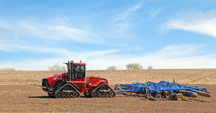 Red Tractor and Plow Royalty Free Stock Photo