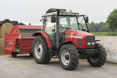Red tractor with red cattle feed diffuser. On a dairy farm Royalty Free Stock Photography