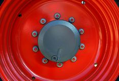 Red tractor rim. Red rim of a new tractor at an Exhibition Royalty Free Stock Photo