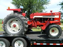 Red Tractor Sitting On Trailer Royalty Free Stock Photos