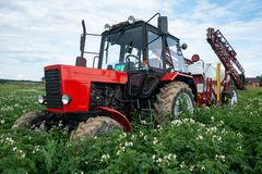 Red tracktor sprayer in the field royalty free stock images