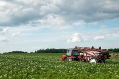 Red tracktor sprayer in the field stock photos