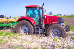 Red tractor. Is stuck in the mud,photography Royalty Free Stock Images