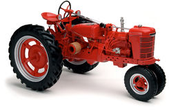 Red tractor on white. Vintage red Farmall tractor on white background Royalty Free Stock Images