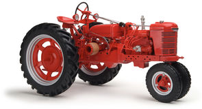 Red tractor on white background. Red Farmall tractor on white background shot at eye level Royalty Free Stock Photo