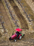 Red Tractor Working in Field Stock Images
