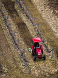 Red Tractor Working in Field Royalty Free Stock Images