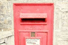 Old postbox scene. The red traditional classic postbox in the wall represent the postal concept related idea Stock Photography