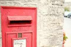 Old postbox scene. The red traditional classic postbox in the wall represent the postal concept related idea Royalty Free Stock Photos