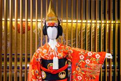 Red Traditional Japanese kimono model. Red Traditional Japanese kimono dressed by artificial blank white model doll with luxury interior background Royalty Free Stock Images