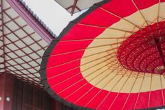 Red traditional Japanese paper umbrella royalty free stock photography