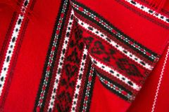 Red traditional romanian carpets. Detail of traditional romanian carpets in the traditional market in Romania made by romanian peasant Stock Photo
