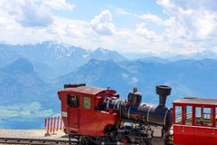 Red Traditional train on the top of European mountain. In Austria stock photo