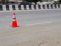 Red traffic cone put on road. Stock Images