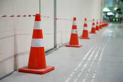 Red traffic cone in the subway Stock Images
