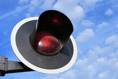 Red traffic-light. Red signal light on blue sky Stock Image