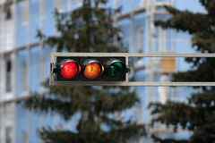Red traffic light. Traffic lights on metal console above road Stock Images
