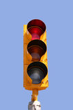 Red Traffic Light. Isolated on blue background Stock Photography