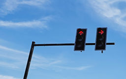 Red traffic light against blue sky Royalty Free Stock Images