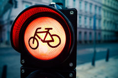 Red traffic light with bicycle sign with urban buildings Stock Photo