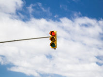Red traffic light on cloud sky background. Stock Photography