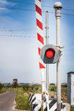Red traffic light crossing level Stock Photo
