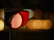 Red traffic light in the dark night city street Royalty Free Stock Image
