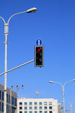 Red traffic light. S with arrow against blue sky background Stock Photo
