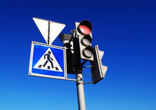 Red traffic light. And pedestrian crossing sign Royalty Free Stock Photos