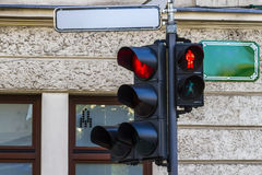 Red traffic light. For pedestrians and vehicles with empty street metallic plates at road intersection in Ljubljana Royalty Free Stock Photography