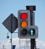 Red traffic light signal. Color photo of a traffic light with a red signal on a background of blue sky Royalty Free Stock Photo
