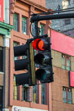 Red traffic light signal hanging in streets of New York Royalty Free Stock Photography